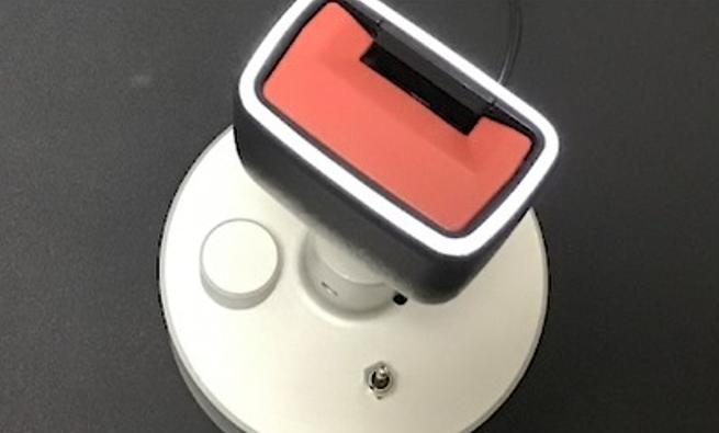 Light guide for seatbelt buckle